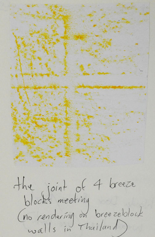 Yellow crayon on breeze block wall